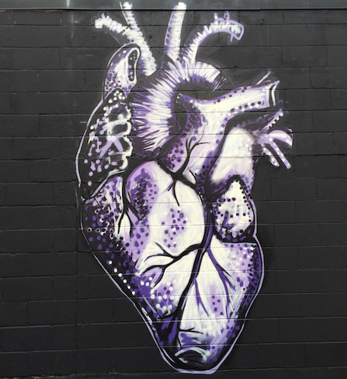 Mural of human heart on cinderblock wall by Jeremy Raymer, Pittsburgh, PA