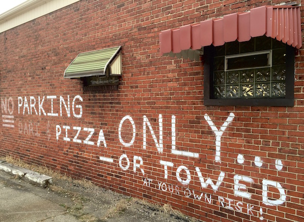 """Painting on brick wall of pizza restaurant reading """"NO Parking Pizza Only ... -- or Towed at your own risk!"""", Homestead, PA"""
