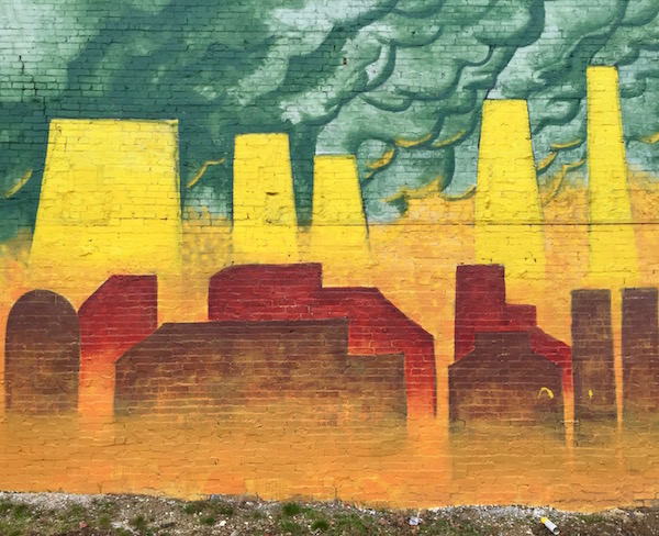 mural of abstract steel mills on brick wall, Hill District, Pittsburgh, PA