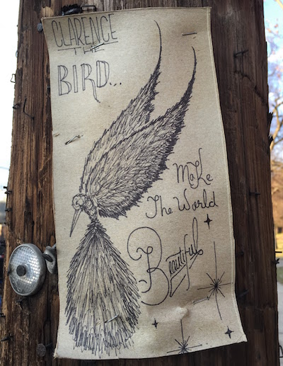 "ink on cardboard street art of a bird with the text ""Clarence the Bird...Make the world beautiful"", Pittsbugh, PA"