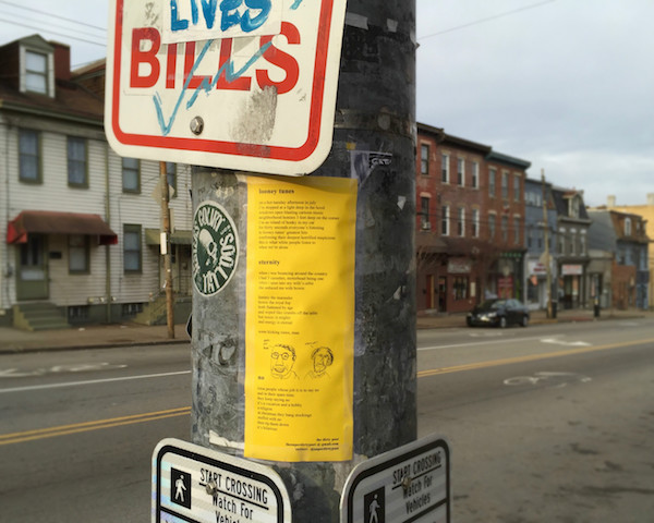 Three of The Dirty Poet's poems taped to a light post, Pittsburgh, PA