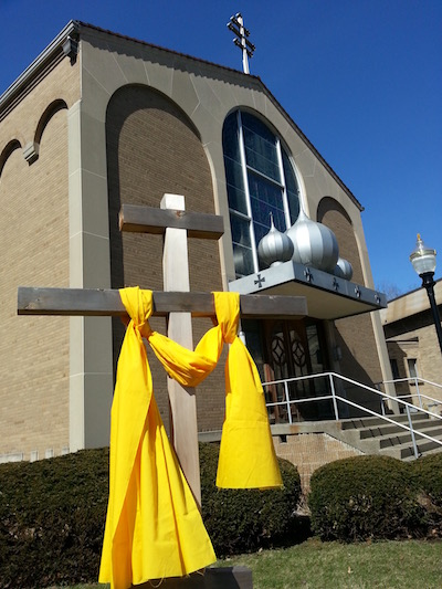 Holy Spirit Byzantine Church with orthodox cross draped in yellow, Pittsburgh, PA