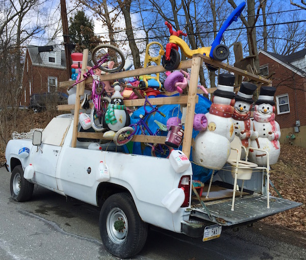 white pickup truck loaded with plastic lawn ornaments childrens toys and a portatoilet - Ross Christmas Decorations