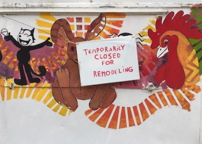 "snack trailer with cartoon images and sign ""Temporarily closed for remodeling"""