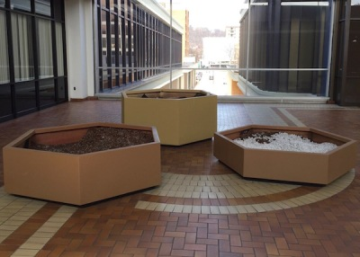 Large hexagon-shaped planters filled with both dirt and styrofoam packing peanuts, Allegheny Center Mall, Pittsburgh, PA