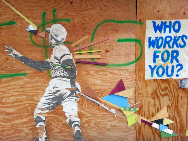 wheat paste and colored wood block street art of Roberto Clemente, Pittsburgh, PA