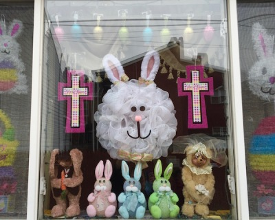 rowhouse window with Easter bunnies and eggs, Pittsburgh, PA