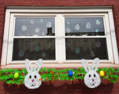 rowhouse windows decorated with Easter bunnies and eggs, Pittsburgh, PA