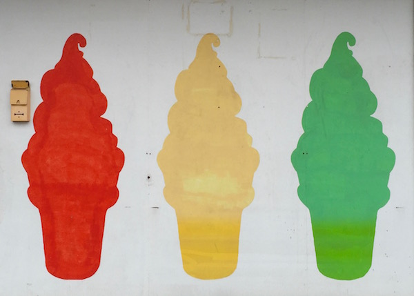 mural of soft-serve ice cream cones in colorful silhouette, former Tastee Queen, Ambridge, PA