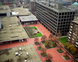 Aerial photo showing Allegheny Center's original open space parklet and red polymer surface