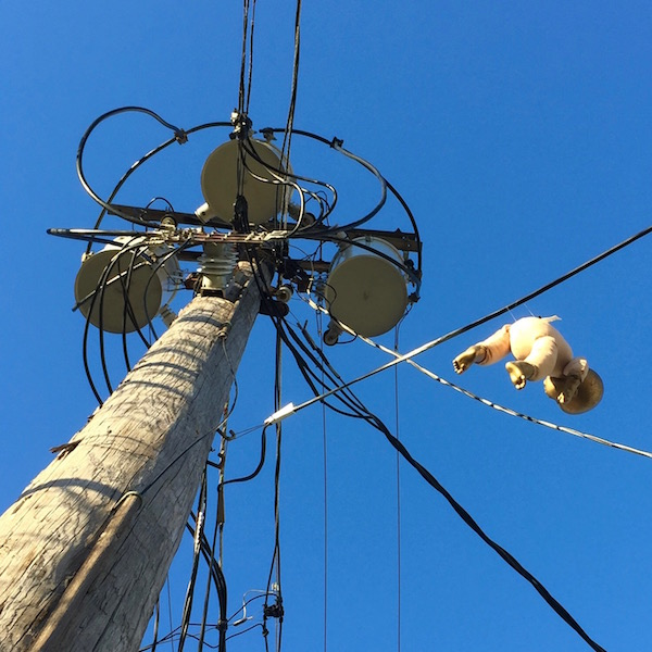 golden baby hanging from electric line, Pittsburgh, PA