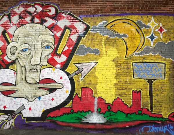 mural on brick wall including the downtown Pittsburgh skyline