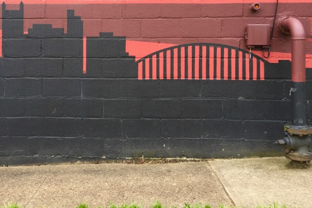 Pittsburgh skyline mural painted on cinderblock building