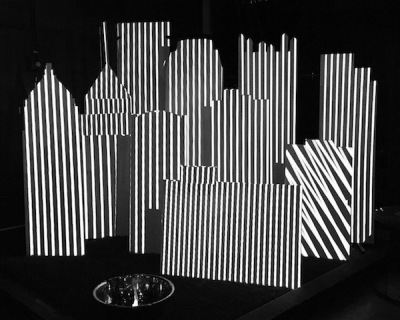 Art installation of Pittsburgh skyline as large cut-outs with black and white patterns projected on them