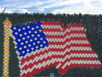 American flag made from red, white, and blue plastic pieces inserted into chain link fence, U.S. Steel/Edgar Thomson Works, Braddock, PA