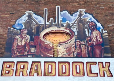 Painting of steel mill and workers with metal and neon lights mounted to brick wall, Braddock, PA