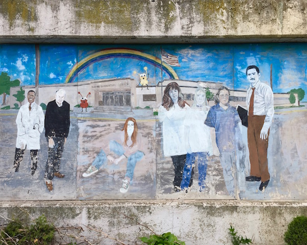 faded mural with a mixed group of people in front of elementary school, Rankin, PA