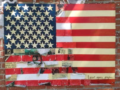 artwork with American flag and news clippings, Clarion, PA