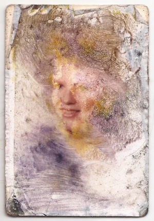water-damaged wallet size photograph of an unknown girl