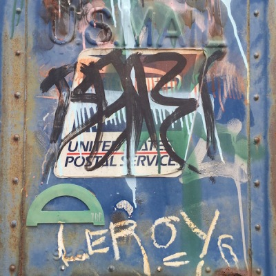 green protractor glued to graffiti-covered mailbox, Pittsburgh, PA