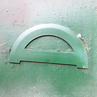 protractor glued to mailbox, both painted hunter green, Pittsburgh, PA