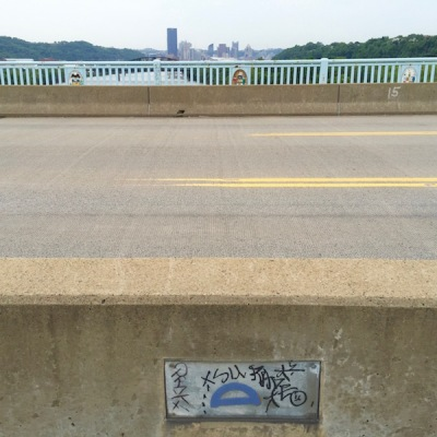 blue protractor glued to metal plate on 40th Street Bridge, Pittsburgh, PA
