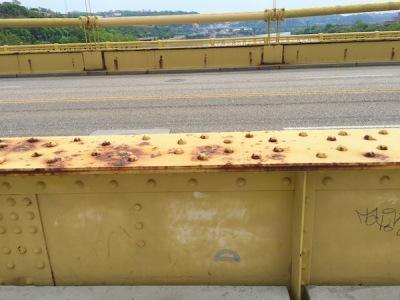 Purple protractor glued to 10th Street Bridge, Pittsburgh, PA