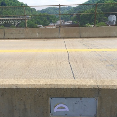purple protractor glued to metal plate on Swinburne Bridge, Pittsburgh, PA