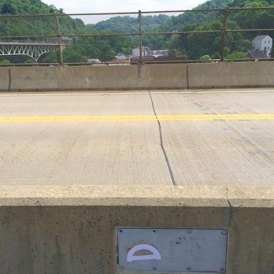 purple protractor glued to metal plate on Swinburne Bridge, Pittsburgh, PA