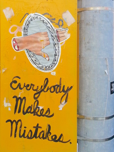 """image of circular saw cutting off fingers with the handwritten text """"Everybody makes mistakes"""", Pittsburgh, PA"""