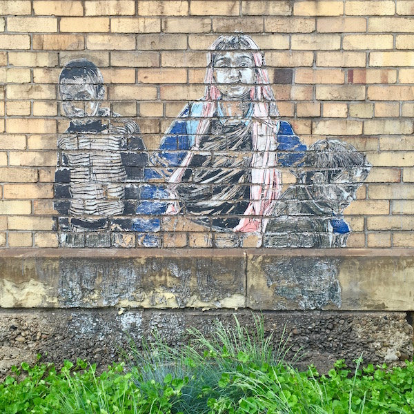 image of three children wheatpasted to brick wall, Braddock, PA