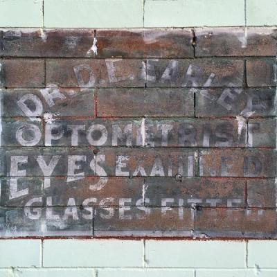 ghost sign for Dr. D.E. Earley, Optometrist, New Martinsville, W. Va.