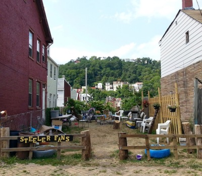 "side yard and fence with sign reading ""Steeler fans"", Pittsburgh, PA"