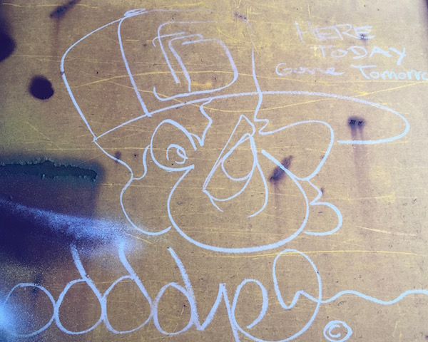 """boxcar graffiti of old man with hat and text """"here today, gone tomorrow"""""""