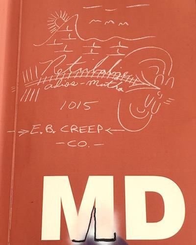 "boxcar graffiti of mountain, sunrise, and train tracks with text ""Retribalize, adios-mutha 10/5"""