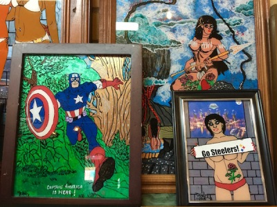 several small, framed paintings by artist JR Holtz