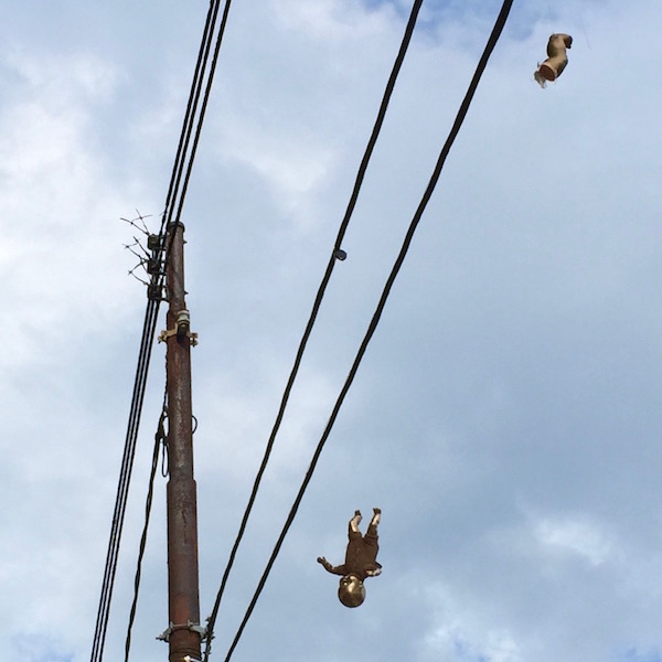 golden baby and baby foot hanging from wires, Pittsburgh, PA