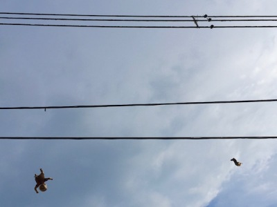 golden baby and baby leg dangling from wires, Pittsburgh, PA