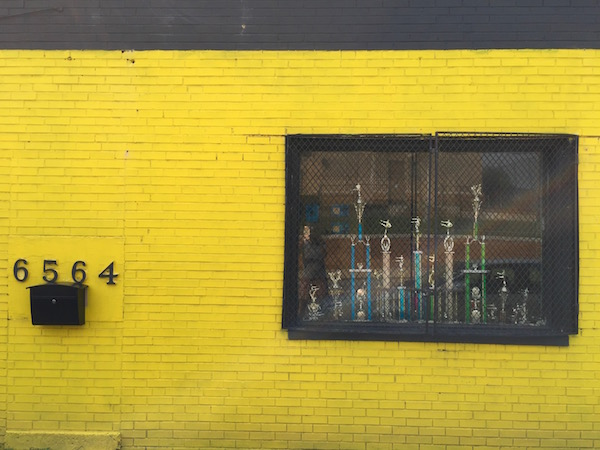 brick building with trophies in the window painted gold with black trim, Pittsburgh, PA
