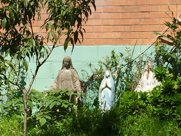 Three statuettes of Mary in front yard of home, Pittsburgh, PA
