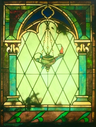 mausoleum stained glass of oil lamp hanging in arched window with columns, Allegheny Cemetery, Pittsburgh, PA
