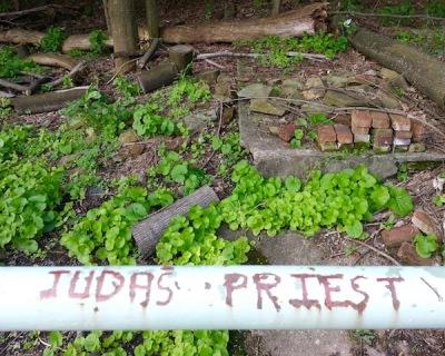 "graffiti of ""Judas Priest"" carved into handrail of city steps, Pittsburgh, PA"