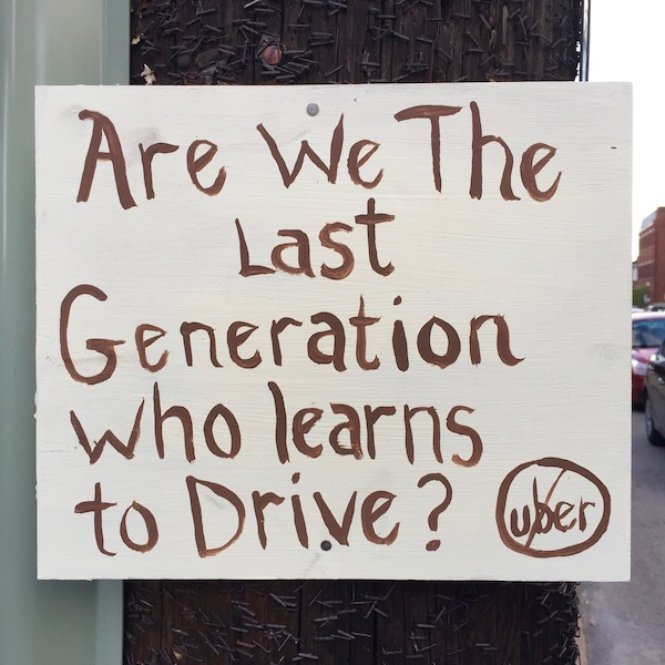 """Handmade sign reading """"Are we the last generation who learns to drive?"""", Pittsburgh, PA"""
