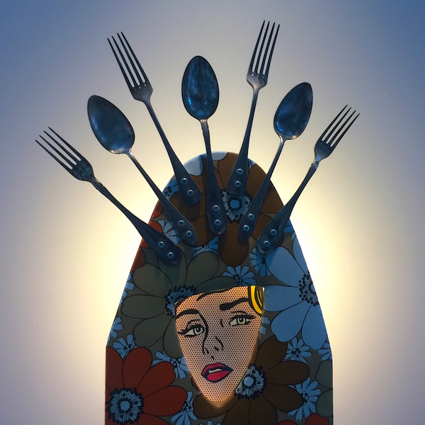 sculpture made from recycled ironing board, silverware, and advertising image by artist Karol Bergeret