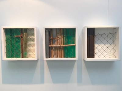 three-piece sculpture of square boxes with recycled fencing and bamboo by artist Felip Gaig
