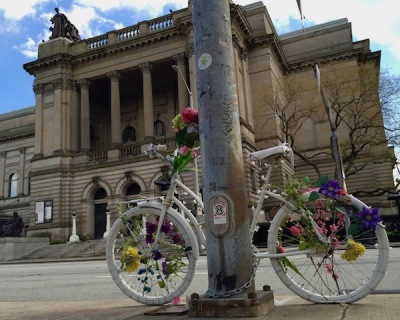 bicycle painted completely white and decorated with flowers and lights, Pittsburgh, PA
