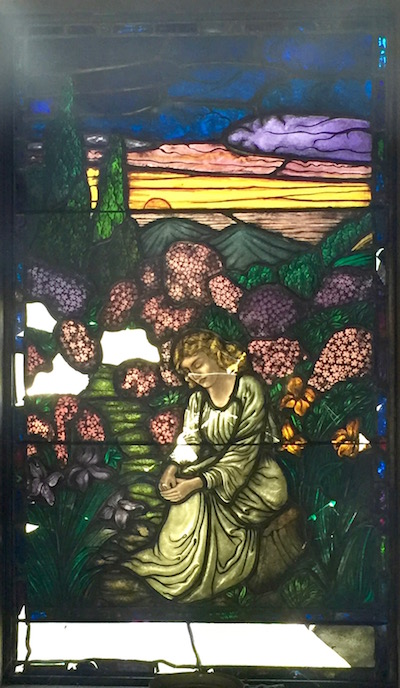 broken mausoleum stained glass with sitting woman and field of flowers, Allegheny Cemetery, Pittsburgh, PA