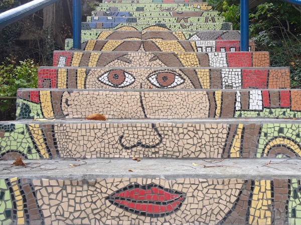 Detail of public steps with mosaic decoration of a woman's head, Pittsburgh, PA
