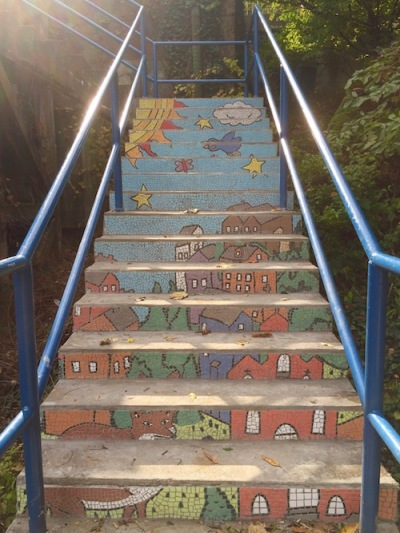 public steps with mosaic decoration including houses, sky, a fox, a bird, sun, and stars, Pittsburgh, PA