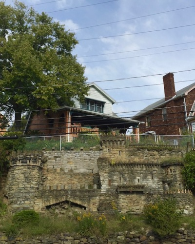 house with retaining wall on hillside constructed to look like medieval castle, Pittsburgh, PA